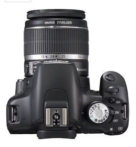 Canon t1i/500d w/book,extra battery, 18-55mm lens DSLR