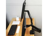 "Dual monitor arm: can hold 2 screens up to 27"" size"