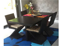 Beautiful 6 seater dining table with 4 designer chairs