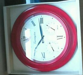 Red clock still in packaging never used