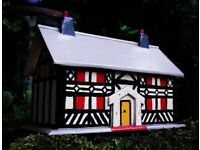 Wooden painted cottage money box