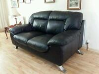 Very modern and clean 2 seater black leather sofa in excellent condition.