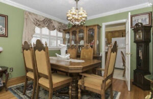 Dining room set with hutch and buffet and six chairs.