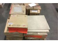 large quantity various floor and wall tiles on pallets