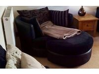 Excellent condition black swivel cuddle chair and footstall. £900 new
