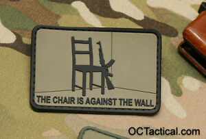 the chair is against the wall red dawn morale patch coyote and black ebay. Black Bedroom Furniture Sets. Home Design Ideas