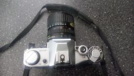 Canon AE1 film camera with 35 - 70 lens in very good condition