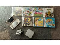 White Nintendo dsi and games