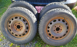 Set of 4 Firestone Winterforce Tires 205/60/16 **ON RIMS***