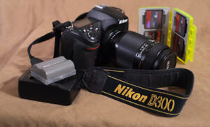 Nikon D300 with Nikon 70-210mm lens, extra battery and cards