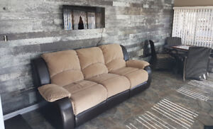 Brown Leather And Microfiber Reclining Couch. (Tyson Collection)