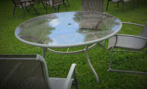 Large round glass patio table