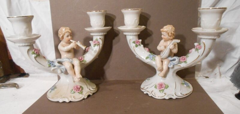Von Schierholz pair of candle holders with cupids playing musical instruments