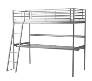 Bunk bed with underneath desk