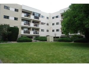 Bright 55+ Top-Floor 2-Bedroom Corner Condo