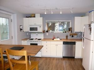 2 bedroom ground level suite - private entrance and laundry