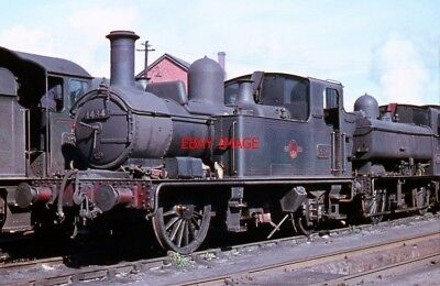 PHOTO  GREAT WESTERN 1400 CLASS 0-4-2T 1434 ON SHED AT EXETER APPEARS TO BE MISS