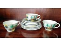 Lovely Japanese print teacups, saucers and side plates