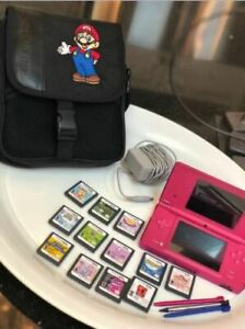 Pink DS with carrying case and numerous games. Like new