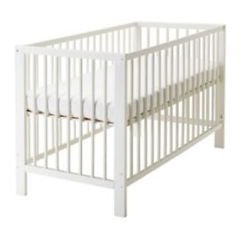 Cot, Mattress, bedding, chest of drawers and shelf unit