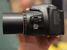 Nikon Coolpix L830 + Lowepro carry. New Condition.