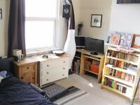 Large double room available in a spacious three story house in the heart of Southville