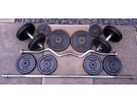 84kg of metal weight plates and 4 x solid bars