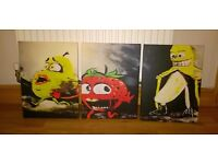 BANANA FLASHING A STRAWBERRY AND PEAR ON THREE CANVASES