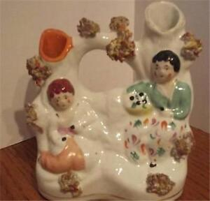ANTIQUE STAFFORDSHIRE FIGURINE, Couple in Garden Spill Vase