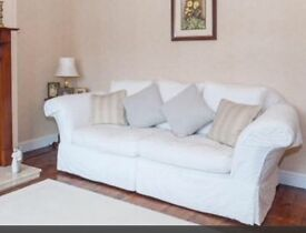 3 seater and 2 seater cream settees.