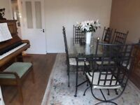 Glass top dining table with 6 chairs (2 carvers)