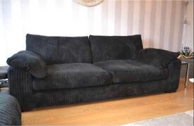 Large black velvet sofa