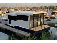 Marina Boat moored in Chichester Marina (ASF: Floating Lodge, House boat)