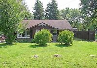 JUST LISTED-SPACIOUS BUNGALOW ON PRIVATE TREED LOT IN ANGUS