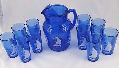 BLUE GLASS PITCHER WITH SAILBOAT DESIGN AND 10 GLASSES
