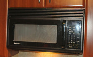 Magic Chef Over the Range Microwave and stove fan in Black