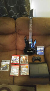 PS3, 1 controller, 5 games and guitar hero for sale