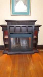 Electric fireplace with lighted glass shelves