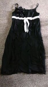Girls Confidential Black dress with white ribbon is size 10 London Ontario image 1