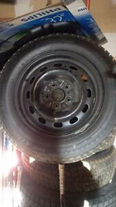 4 205/65R16 SNOW TIRES WITH STEEL RIMS LIKE NEW
