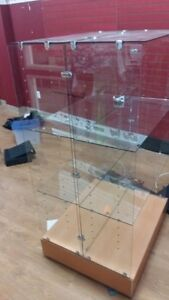 Double sided glass shelving unit