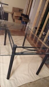 Glass and wrought iron dining room table