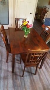 Wooden rectangular table with four chairs