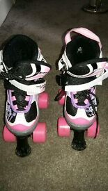 Two pairs of roller boots