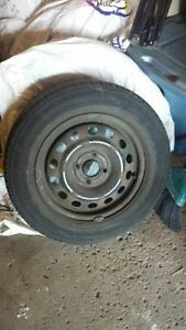 4 season tires with rims 185/65/14 for sale