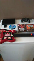 PS2 SLIM WITH A CONTROLLER, MEMORY CARD AND GUITAR HERO