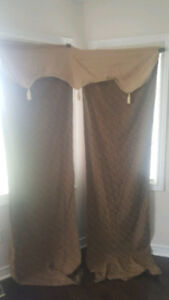 Two Brown and golden curtain panels