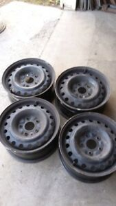 4 16 inch, 5 bolt hole rims from a 2008 Dodge Caravan