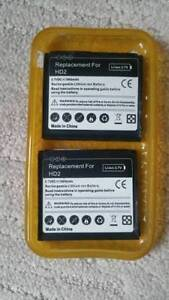 HTC HD2 2 spare batteries and the protection case