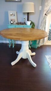 Refinished solid wood table